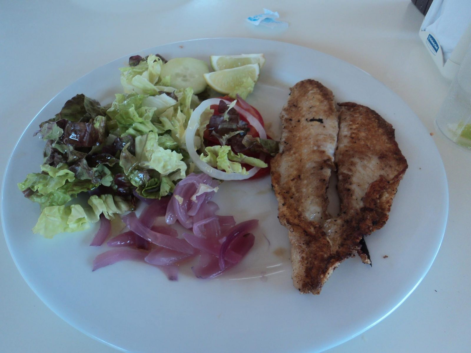 Grilled fish at Punta Emila beach bar at lunch