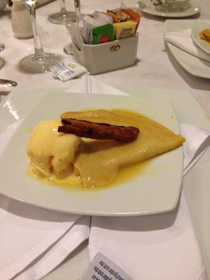 Brandy crepes with vanilla bean ice cream. Made for us by Adolfo at El Jardin our last night. I miss him so much by Amanda Glaab Bergman